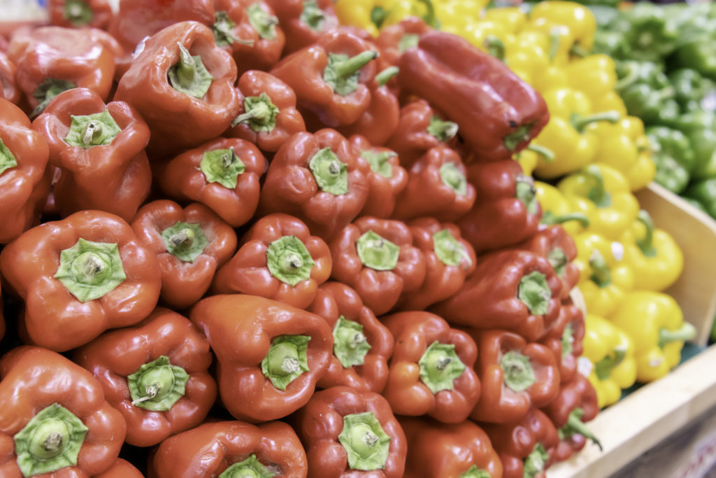 Organic fresh Red, Yellow, and Green Peppers for sale in a supermarket