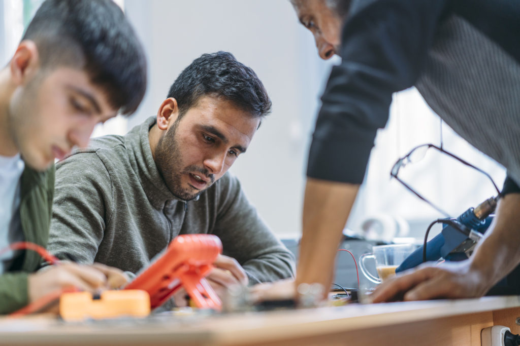 Male students are taking electronic equipment repairing classes.