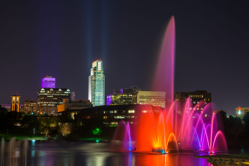 Downtown Omaha skyline with a beautifully lit fountain at night.