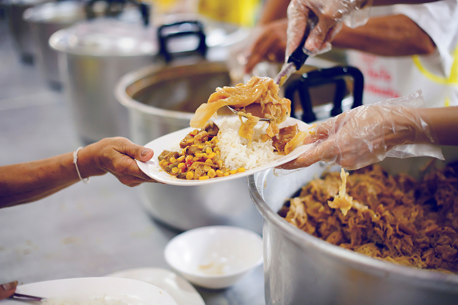 Food being handed out at a soup kitchen