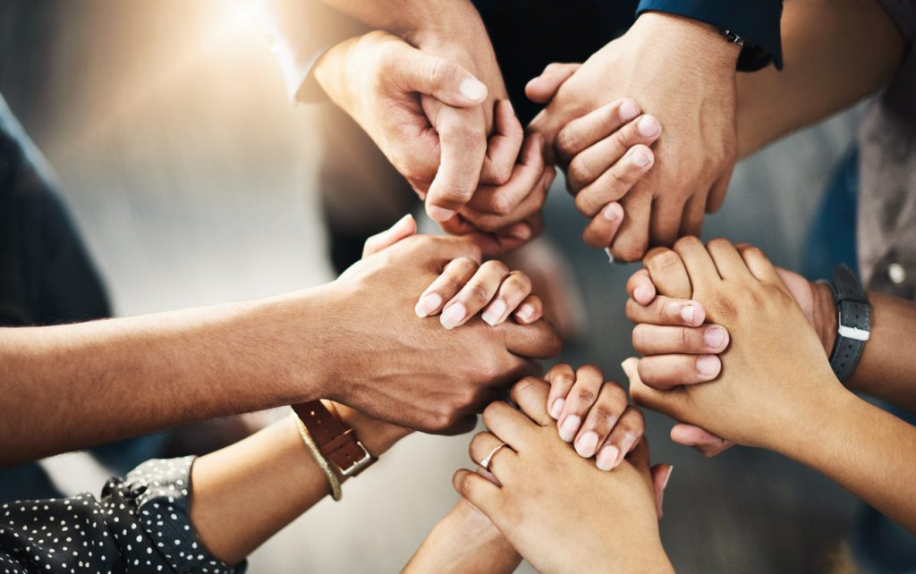 Shot of a group of unrecognizable people holding hands