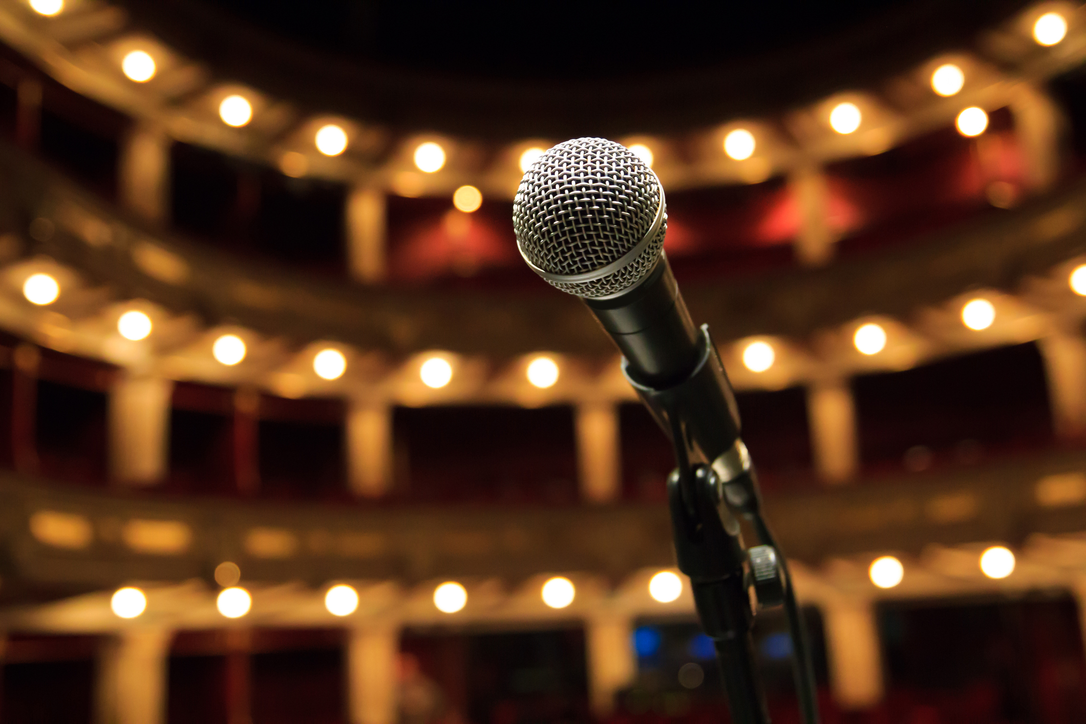 Close up of microphone in concert hall, theater