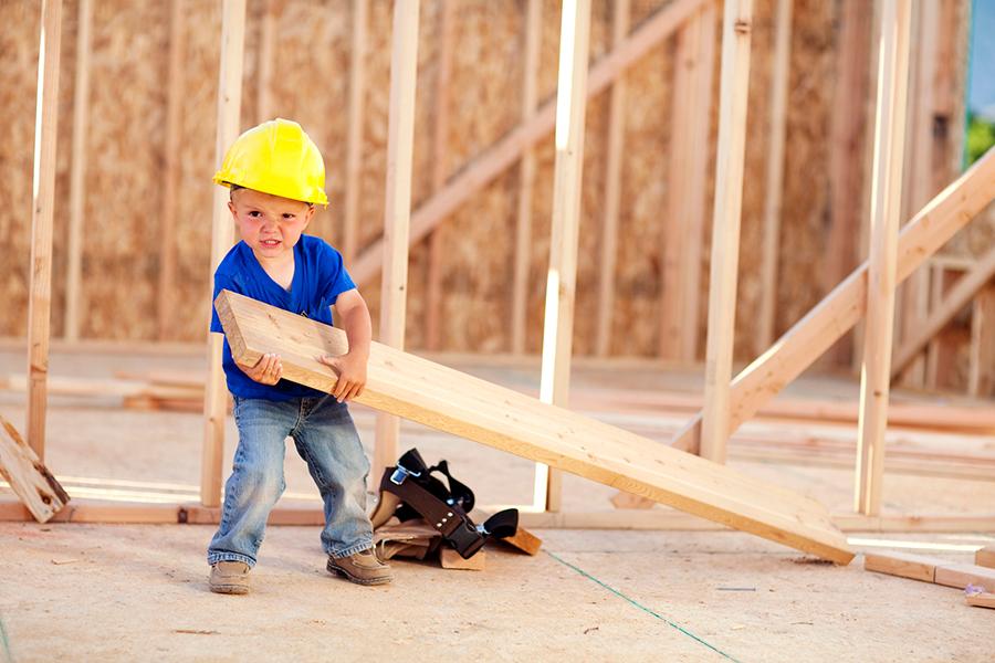 little boy on construction site