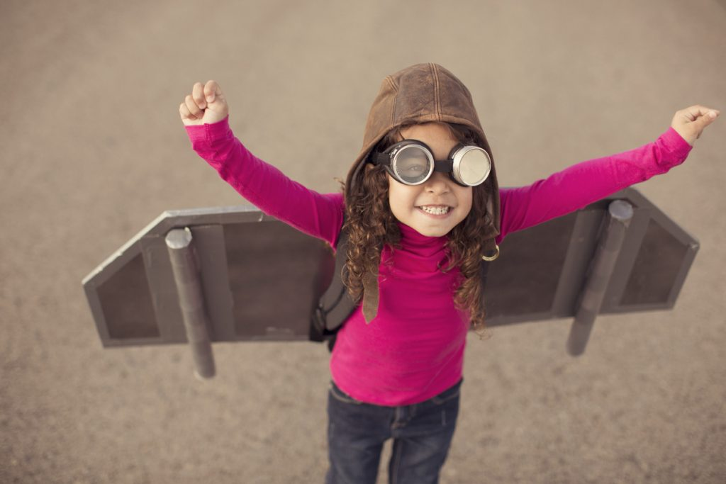 A young girl dreams of flying in the sky.