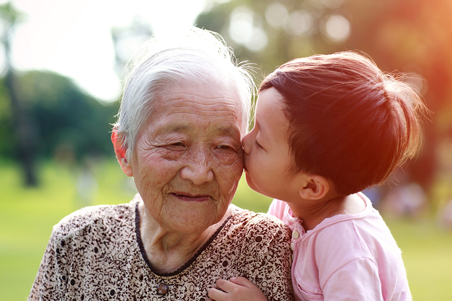 A little girl kissing her grandmother