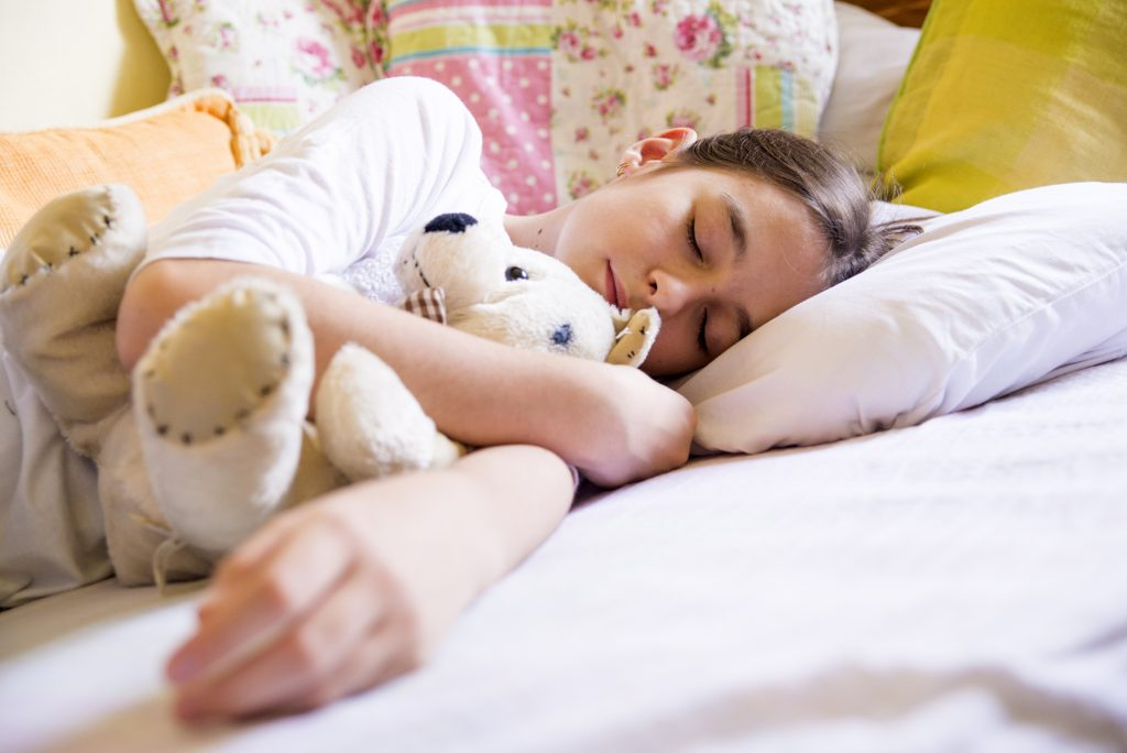 Dreaming girl, Girl sleeping with teddy bear - health and beauty concept - little girl with teddy bear sleeping at home, Young girl taking a peaceful nap with her favorite teddy bear