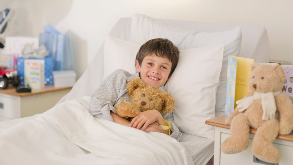 Boy recovering in hospital bed