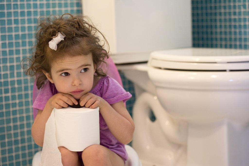 little girl sitting on the potty in the bathroom
