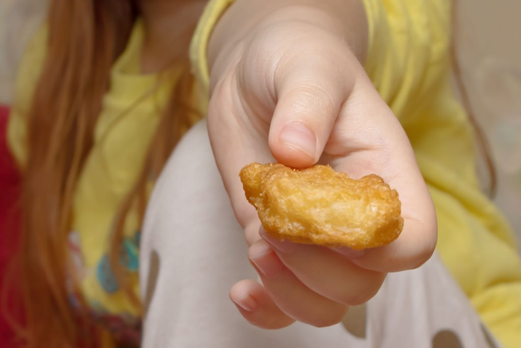 junk food kids nuggets close-up hand