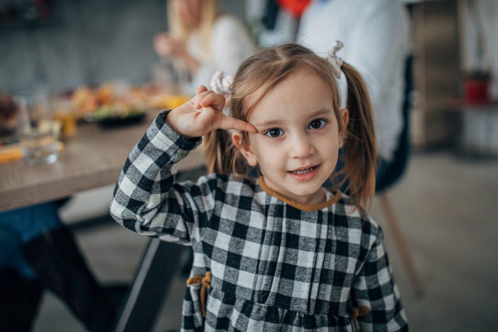 Cute little girl in plaid dress.