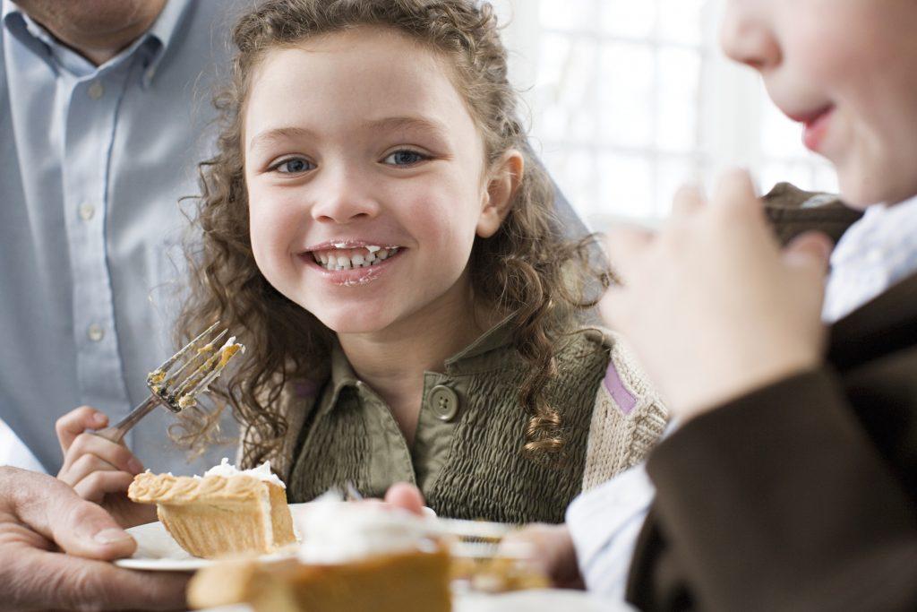 Girl eating pie