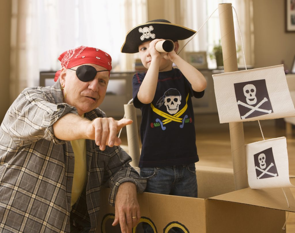 Grandfather and grandson playing pirates
