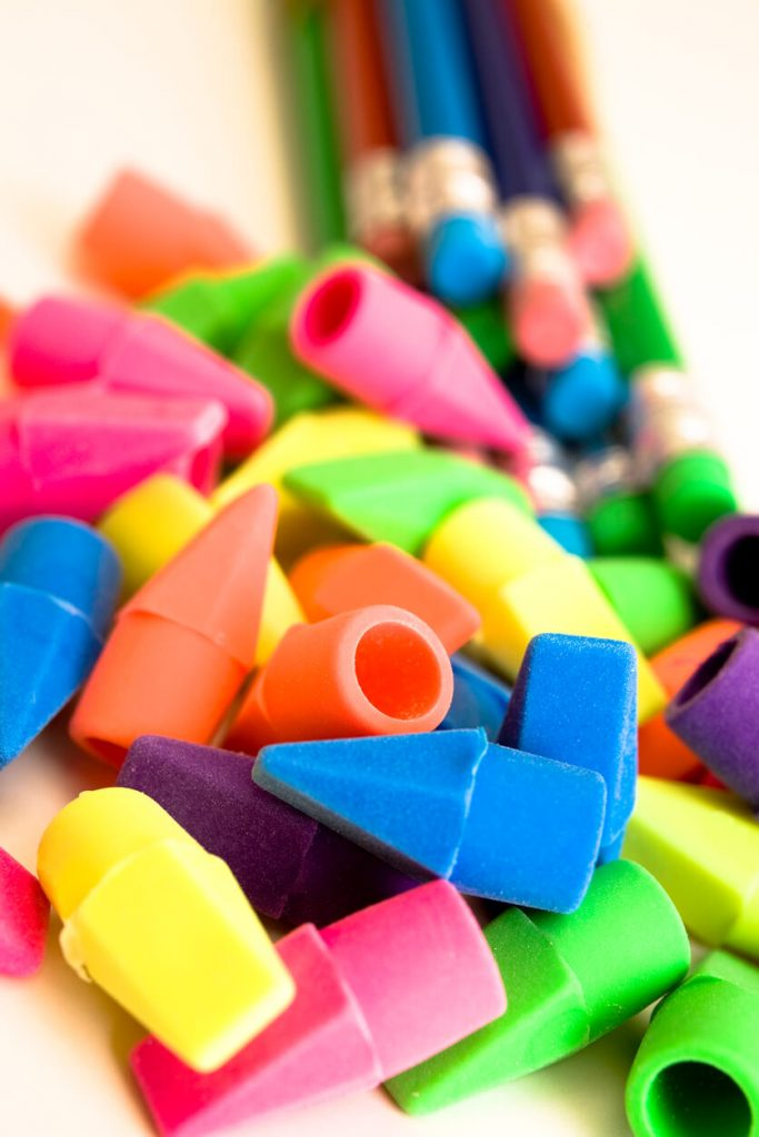 Vibrantly colored erasers and pencils